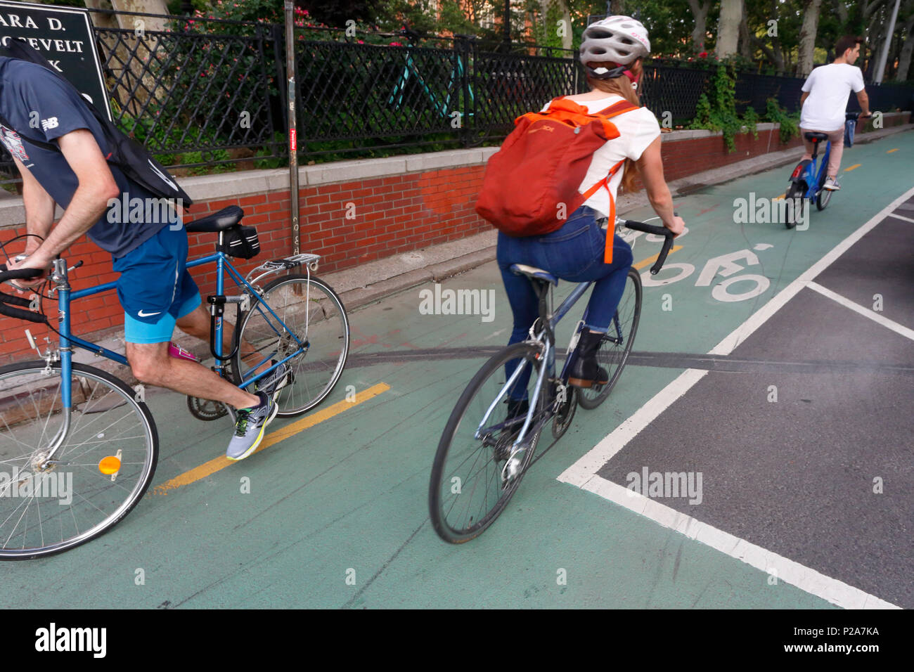 Bicyclists on a bicycle lane on Chrystie, and E. Houston St. - Stock Image