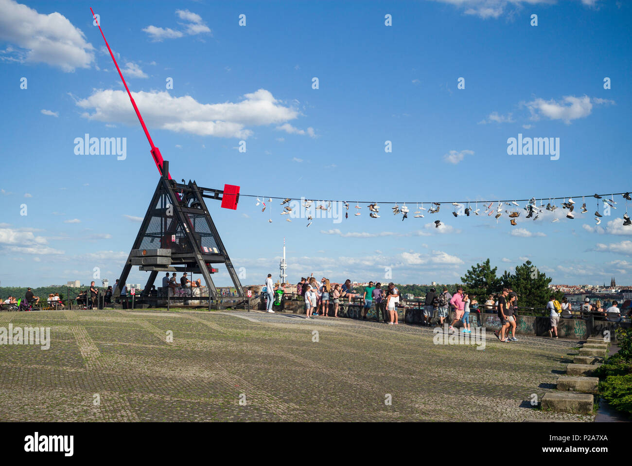 Prague. Czech Republic. People gather at the Metronome in Letná Park for views across the city. Stock Photo