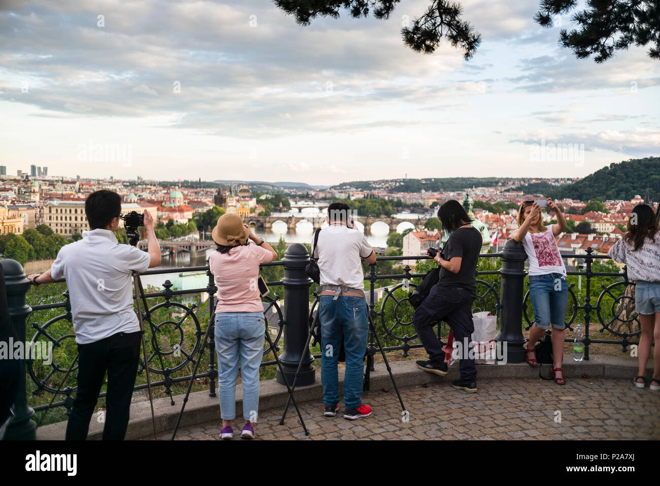 Prague. Czech Republic. Tourists taking photos of the view from Letná Park which provides a viewpoint of the Vltava River and the Old Town (Staré Měst - Stock Image