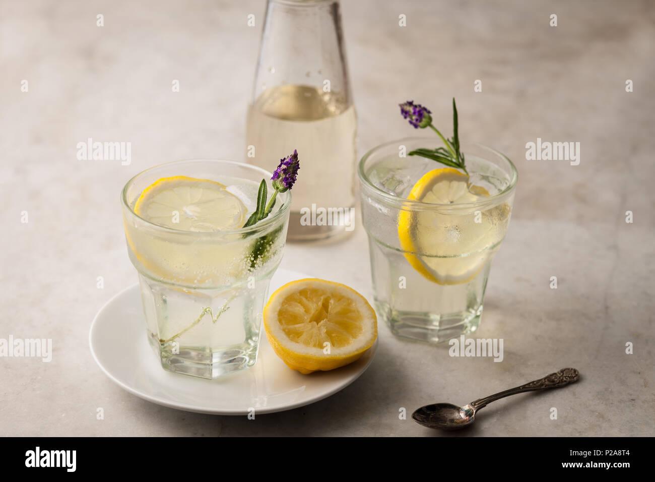 Citrus lemonade with lemon slices and lavender - Stock Image