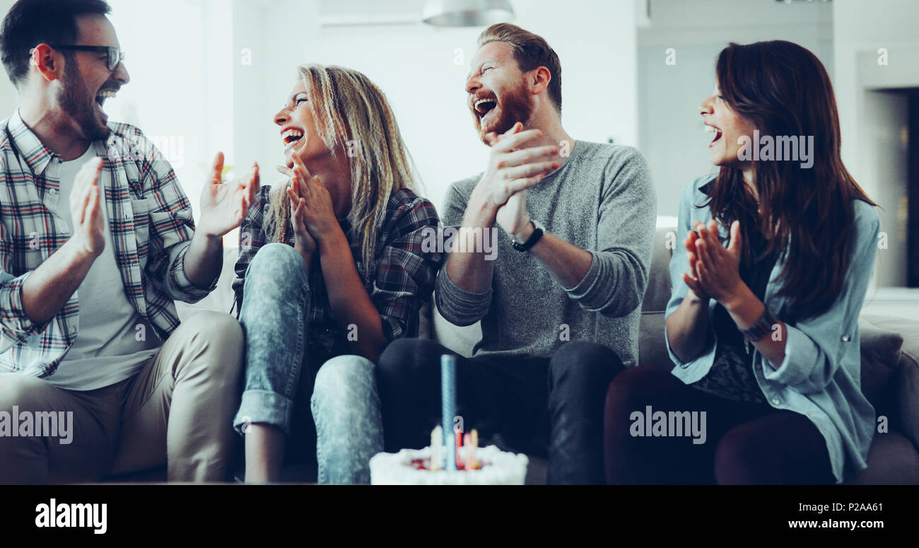 Young group of happy friends celebrating birthday Stock Photo