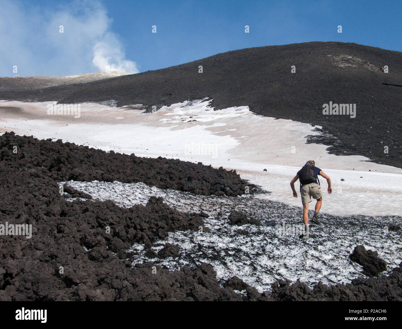 To the top of the Etna volcano, Hikers go on the lava fields to the summit of Etna - Stock Image