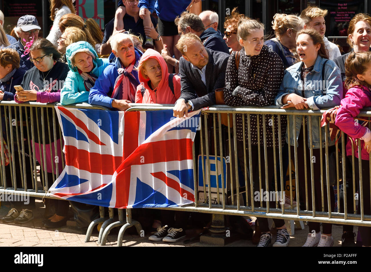 Chester, UK. 14th June 2018. Crowds await the arrival of the Queen and the Duchess of Sussex to officially open the Storyhouse theatre, library and arts venue before having lunch in the Town Hall. Credit: Andrew Paterson/Alamy Live News - Stock Image
