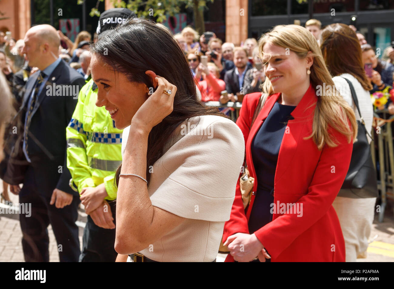 Chester, UK. 14th June 2018. The Duchess of Sussex on a walkabout outside the Storyhouse theatre, library and arts venue on the way to having lunch in the Town Hall. Credit: Andrew Paterson/Alamy Live News - Stock Image