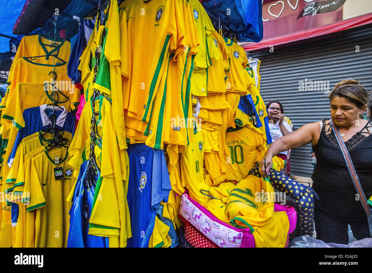 Sao Paulo, Brazil. 14th June, 2018. Shoppers pass on a street decorated in Brazilian flags ahead of the FIFA World Cup games in downtown Sao Paulo, Brazil. In a curious quirk of Brazil's electoral calendar, for the last 28 years Latin America's largest economy has gone to the polls shortly after the World Cup. In the football-obsessed country, politicians have long attempted to hijack the sport to burnish their image. Credit: Cris Faga/ZUMA Wire/Alamy Live News - Stock Image