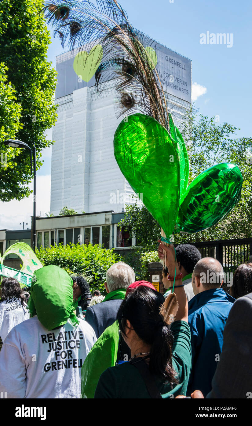 Friends and family members walk towards Grenfell Tower, to mark the one year anniversary of the fire, London, England, UK, 14th June 2018 - Stock Image
