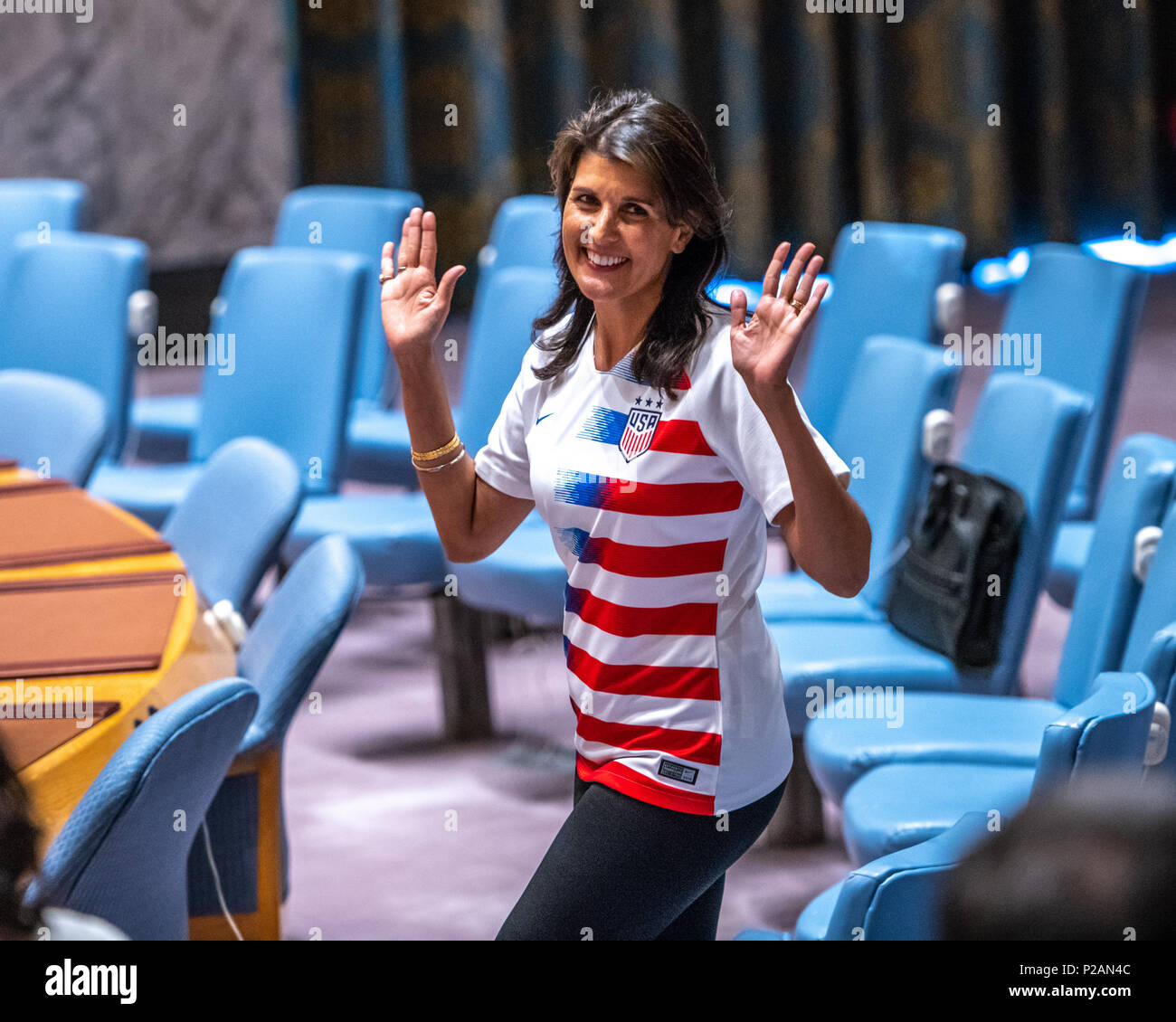 New York, USA, 14 June 2018. US Ambassador to the UN Nikki Haley wears a USA soccer jersey as she  enters the Security Council to attend an event marking the opening day of the 2018 FIFA World Cup, being hosted by the Russian Federation from 14 June to 15 July. Credit: Enrique Shore/Alamy Live News - Stock Image