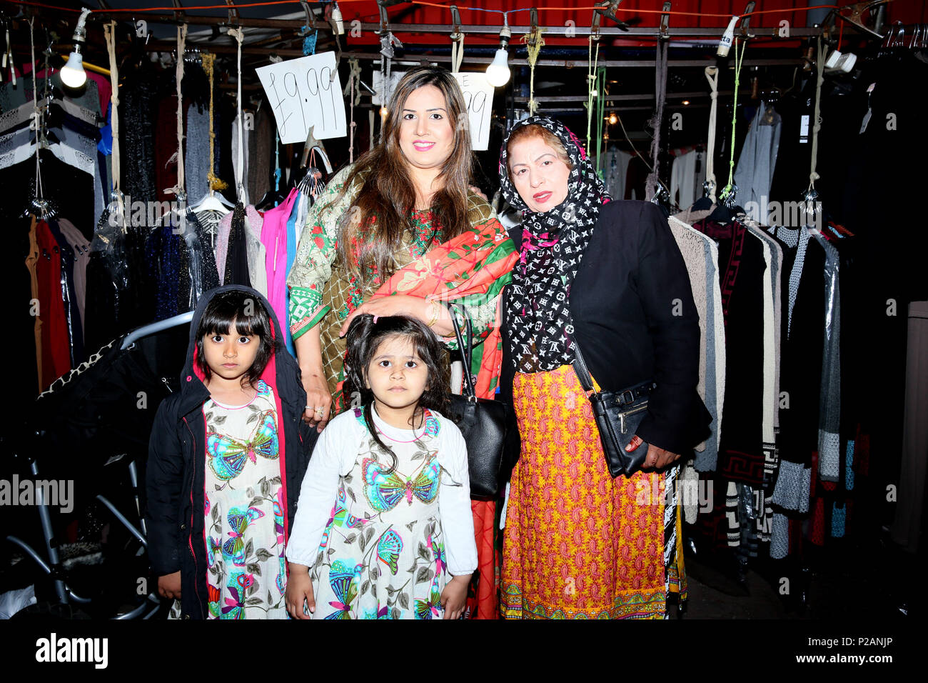 Manchester, UK. 14th June 2018. Muslim families celebrate Chaand Raat, which translated literally means night of the moon.  The festival marks the end of Ramadam and the night before Eid. Longsight Market, Manchester, 14th June, 2018 (C)Barbara Cook/Alamy Live News - Stock Image