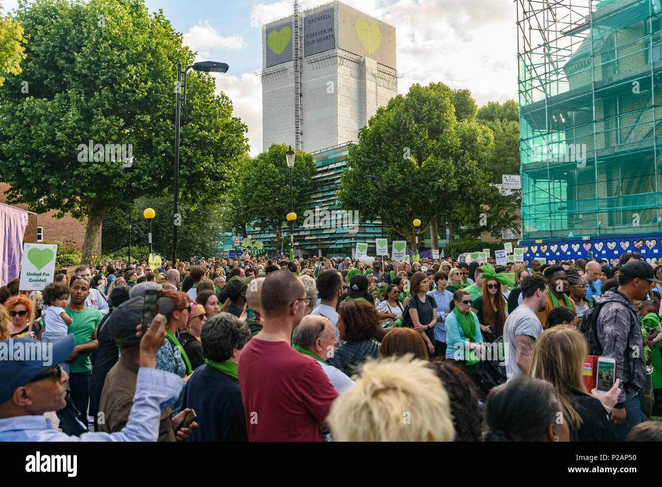 London, UK. 14th June 2018. Thousands walk in silence from close to Grenfell Tower remembering the victims of the disaster on the first anniversary of the disastrous fire which killed 72 and left survivors traumatised. Many of those made homeless by the fire are still in temporary accomodation a year later despite promises mde by Theresa May and Kensington & Chelsea council, who many fell have failed the local community both before and after the fire.  call for justice and for those responsible to be prosecute Credit: Peter Marshall/Alamy Live News - Stock Image