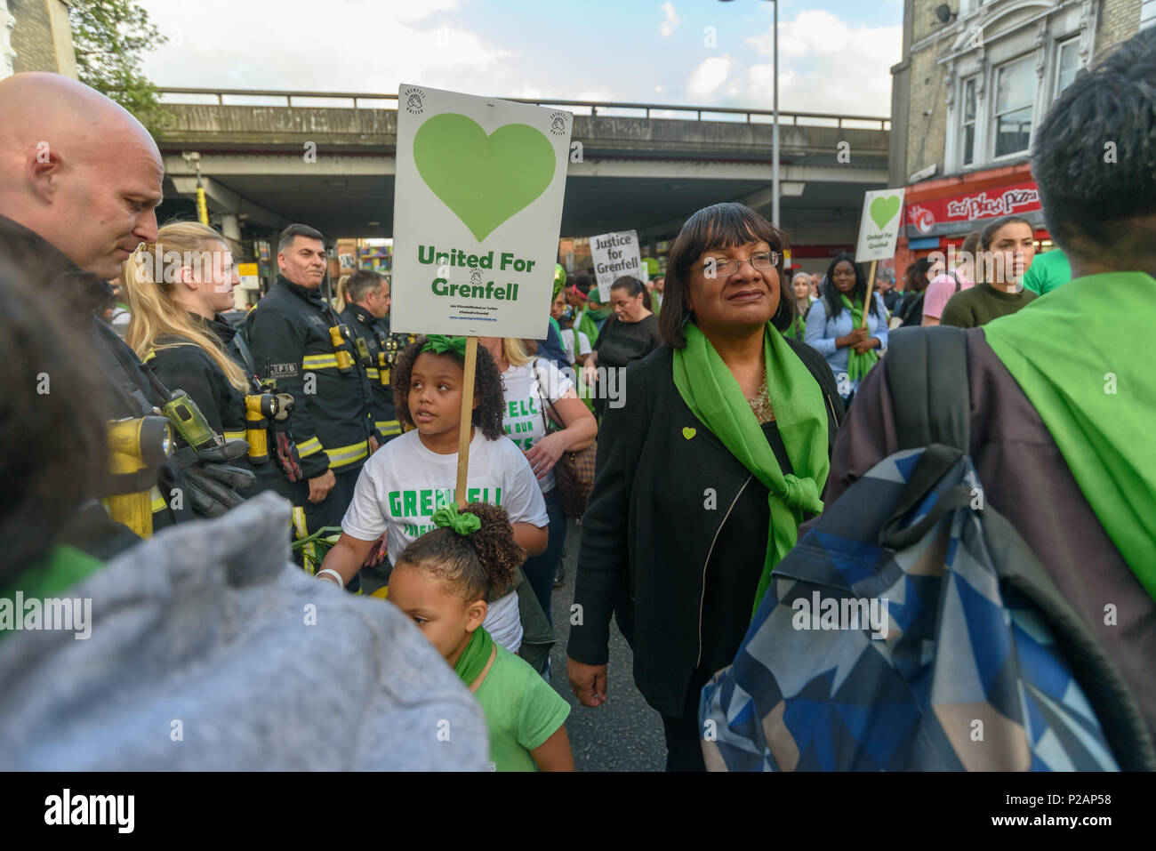 London, UK. 14th June 2018. Shadow Home Secretary Diane Abbot at Ladbroke Grove in the silent walk from close to Grenfell Tower remembering the victims of the disaster on the first anniversary of the disastrous fire which killed 72 and left survivors traumatised. Many of those made homeless by the fire are still in temporary accomodation a year later despite promises mde by Theresa May and Kensington & Chelsea council, who many fell have failed the local community both before and after the fire.  call for just Credit: Peter Marshall/Alamy Live News - Stock Image