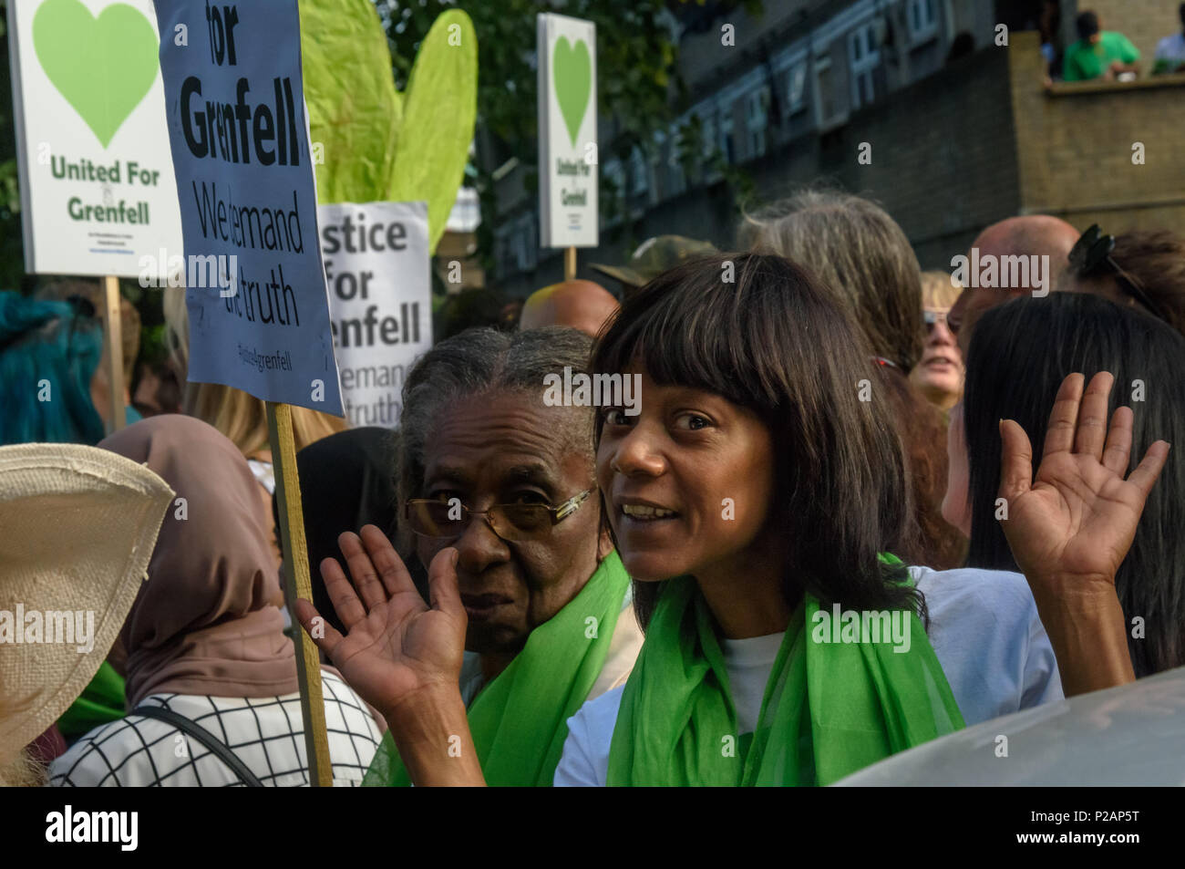 London, UK. 14th June 2018. A community associatin leader poses for the camer as thousands line up to walk in silence from close to Grenfell Tower remembering the victims of the disaster on the first anniversary of the disastrous fire which killed 72 and left survivors traumatised. Many of those made homeless by the fire are still in temporary accomodation a year later despite promises mde by Theresa May and Kensington & Chelsea council, who many fell have failed the local community both before and after the fire. They say had they been listened to and respected Grenfell would not have happene - Stock Image