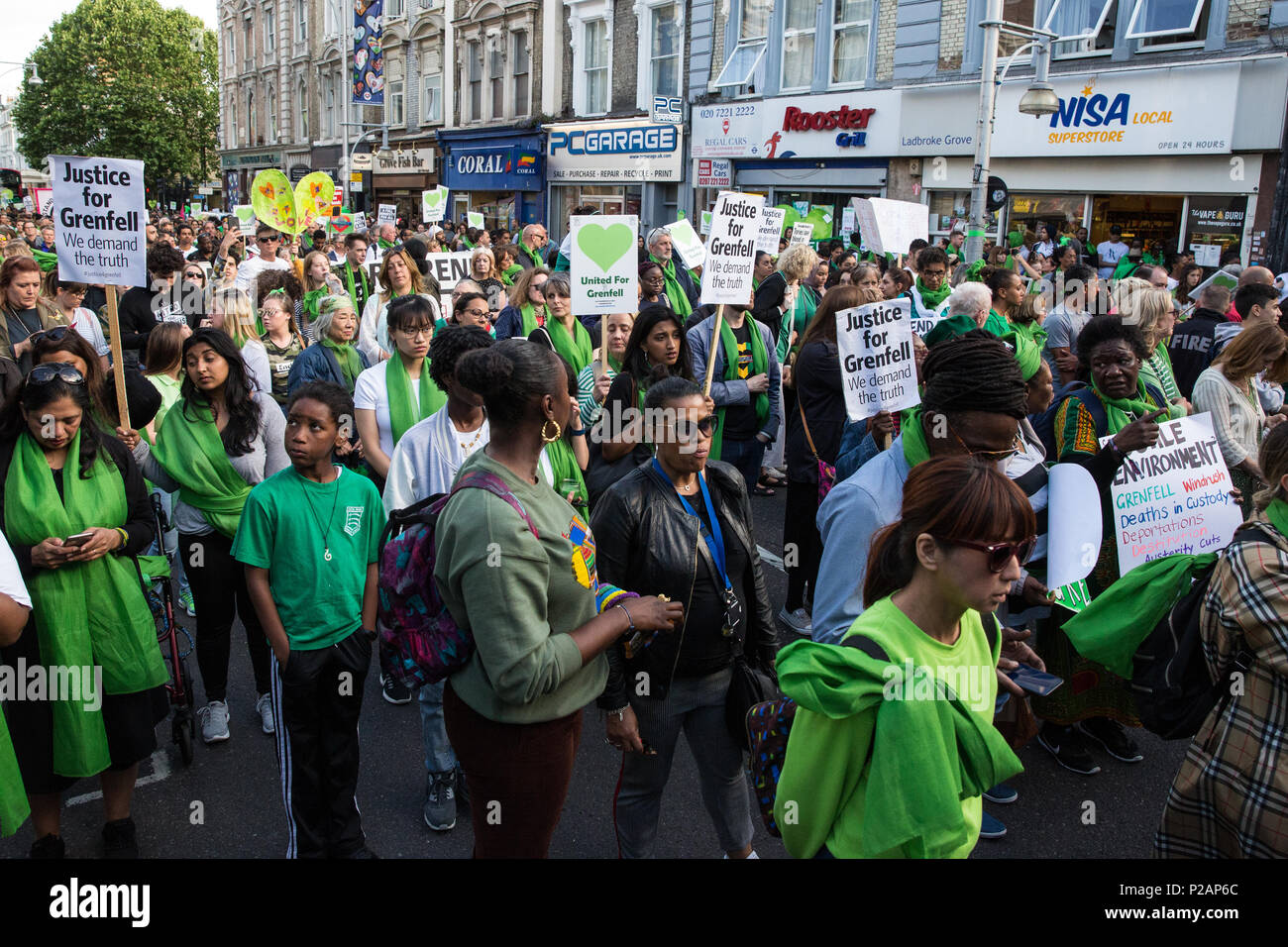 London, UK. 14th June, 2018. Members of the Grenfell community and supporters take part in the Grenfell Silent March through West Kensington on the first anniversary of the Grenfell Tower fire. 72 people died in the Grenfell Tower fire and over 70 were injured. Credit: Mark Kerrison/Alamy Live News - Stock Image