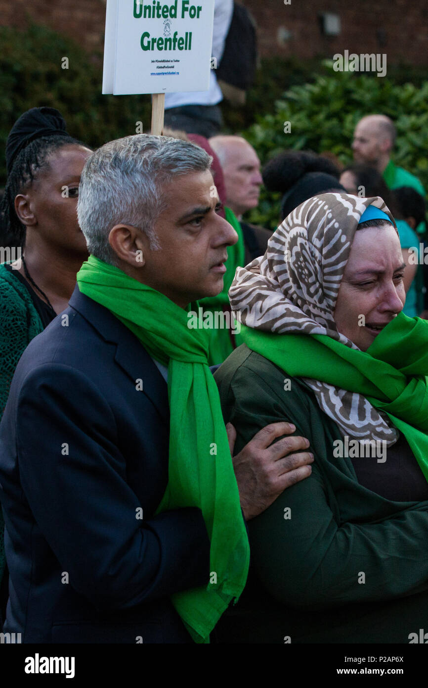 London, UK. 14th June, 2018. Mayor of London Sadiq Khan consoles a woman during the Grenfell Silent March through West Kensington on the first anniversary of the Grenfell Tower fire. 72 people died in the Grenfell Tower fire and over 70 were injured. Credit: Mark Kerrison/Alamy Live News - Stock Image