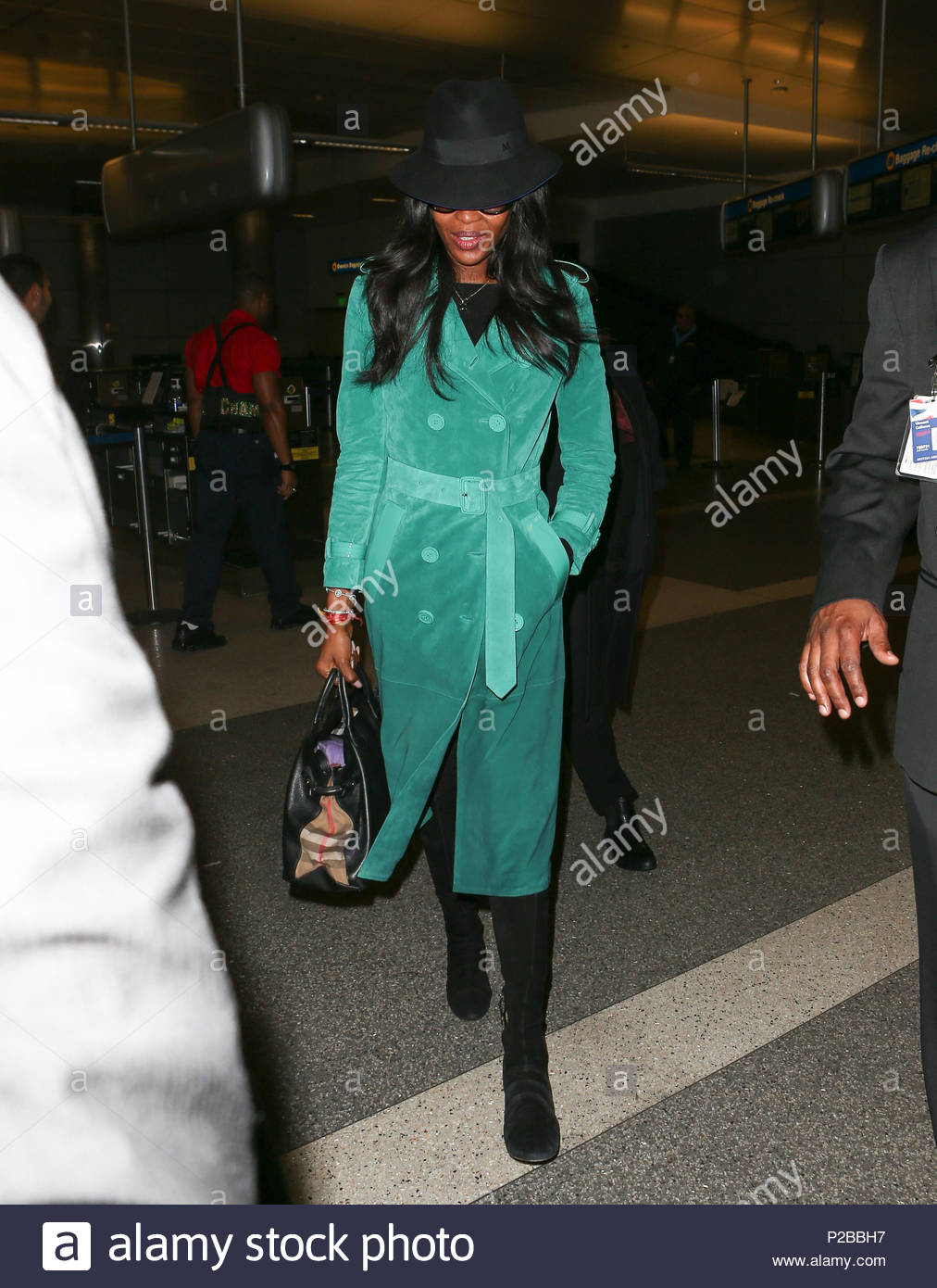 Naomi Campbell Mandatory Byline To Read Infphotocom Onlybr Coat Is Seen Arriving At Lax International Airport In Los Angeles California Wearing A Bright Green