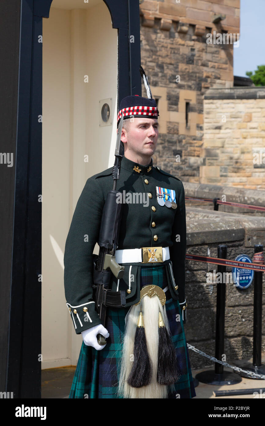 Edinburgh Castle guard in full uniform including scottish tartan kilt, Edinburgh old town, Edinburgh Scotland UK Stock Photo