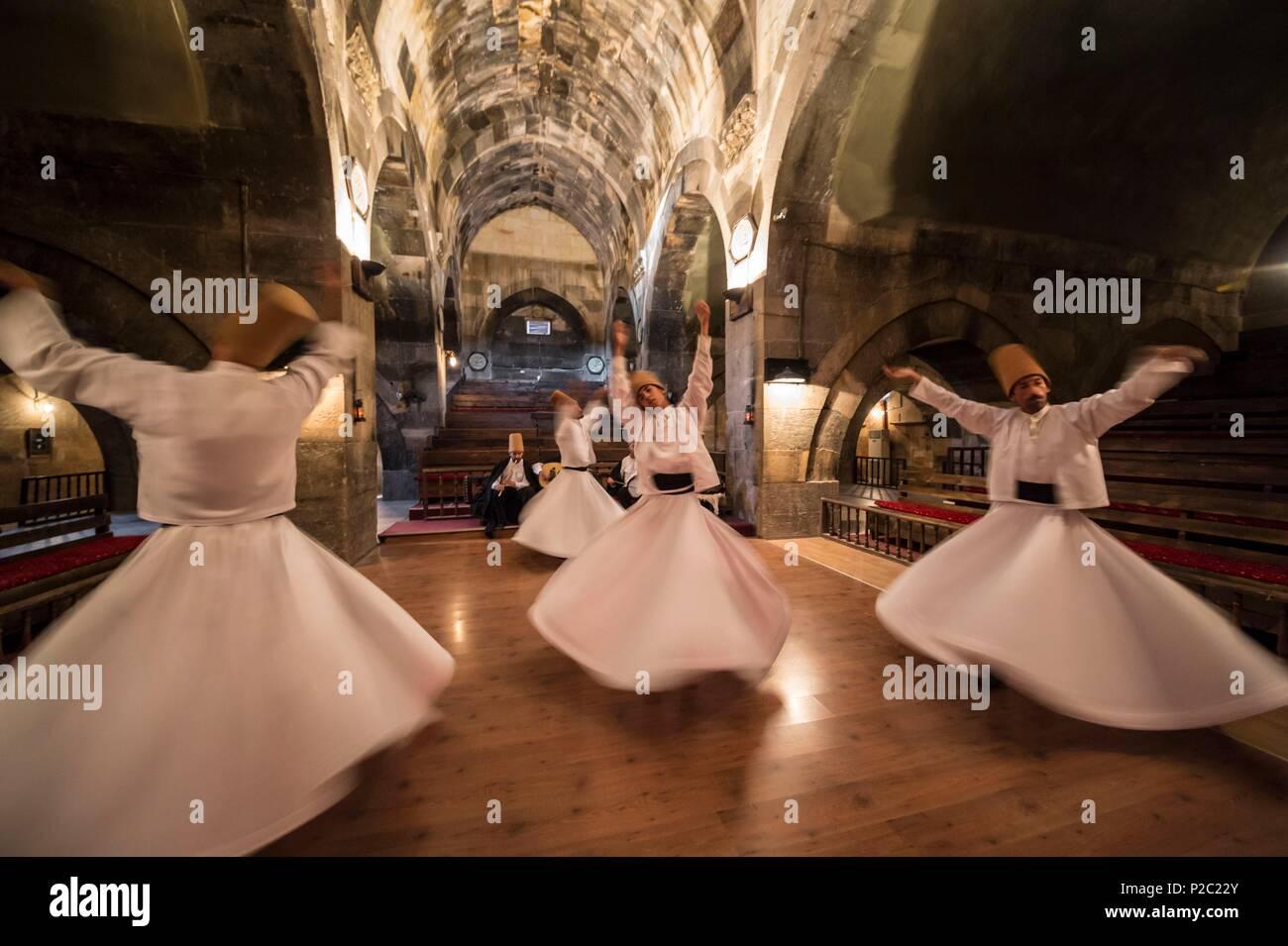 Turkey, Central Anatolia, Nevşehir province, Cappadocia UNESCO World Heritage Site, Avanos, ceremony of whirling dervishes at Sarihan Seljuk caravanserai, built in 1249, on the Silk Road - Stock Image