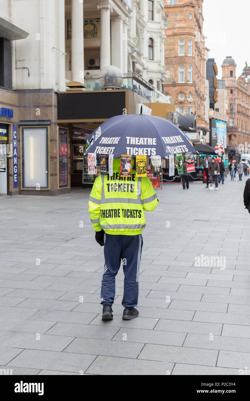 Man promoting half price theatre tickets, Leicester Square, London, England - Stock Image