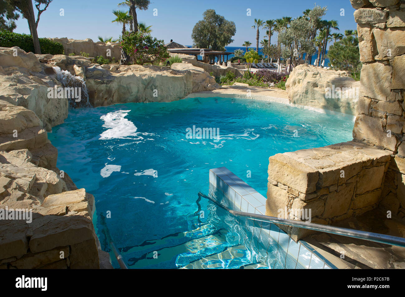 Pool in artificial rocks in the spa at the Le Meridien Hotel, Limassol, Limassol District, Cyprus Stock Photo