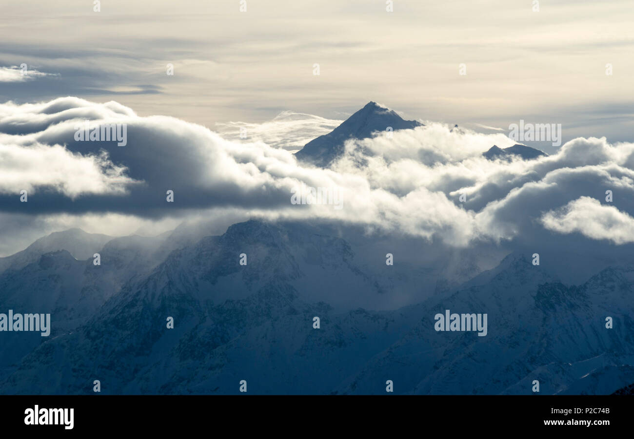 The summit of Weisshorn protruding through the clouds, Pennine Alps, canton of Valais, Switzerland - Stock Image