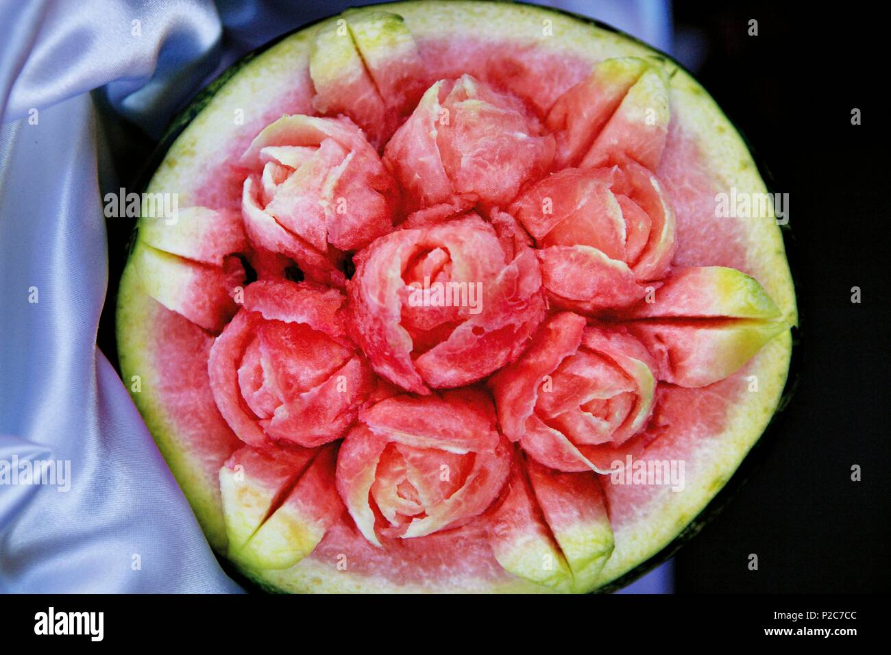 Azerbaijan, Baku, Baku Boulevard, an intricate rose bouquet out of a watermelon carved for Norouz (new year in ancient persia) - Stock Image