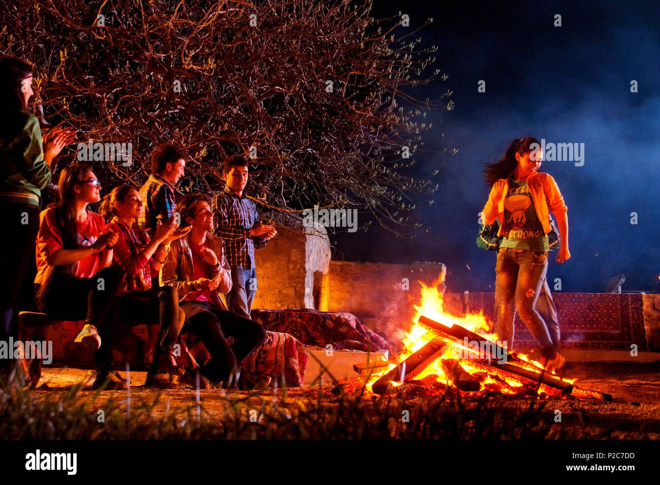 Azerbaijan, viciniti Baku, Absheron Peninsula, Gala (Qala) Village, Azerbaijani teens perform a bonfire jumping ritual during a Novruz (new year in ancient Perisa) celebration - Stock Image