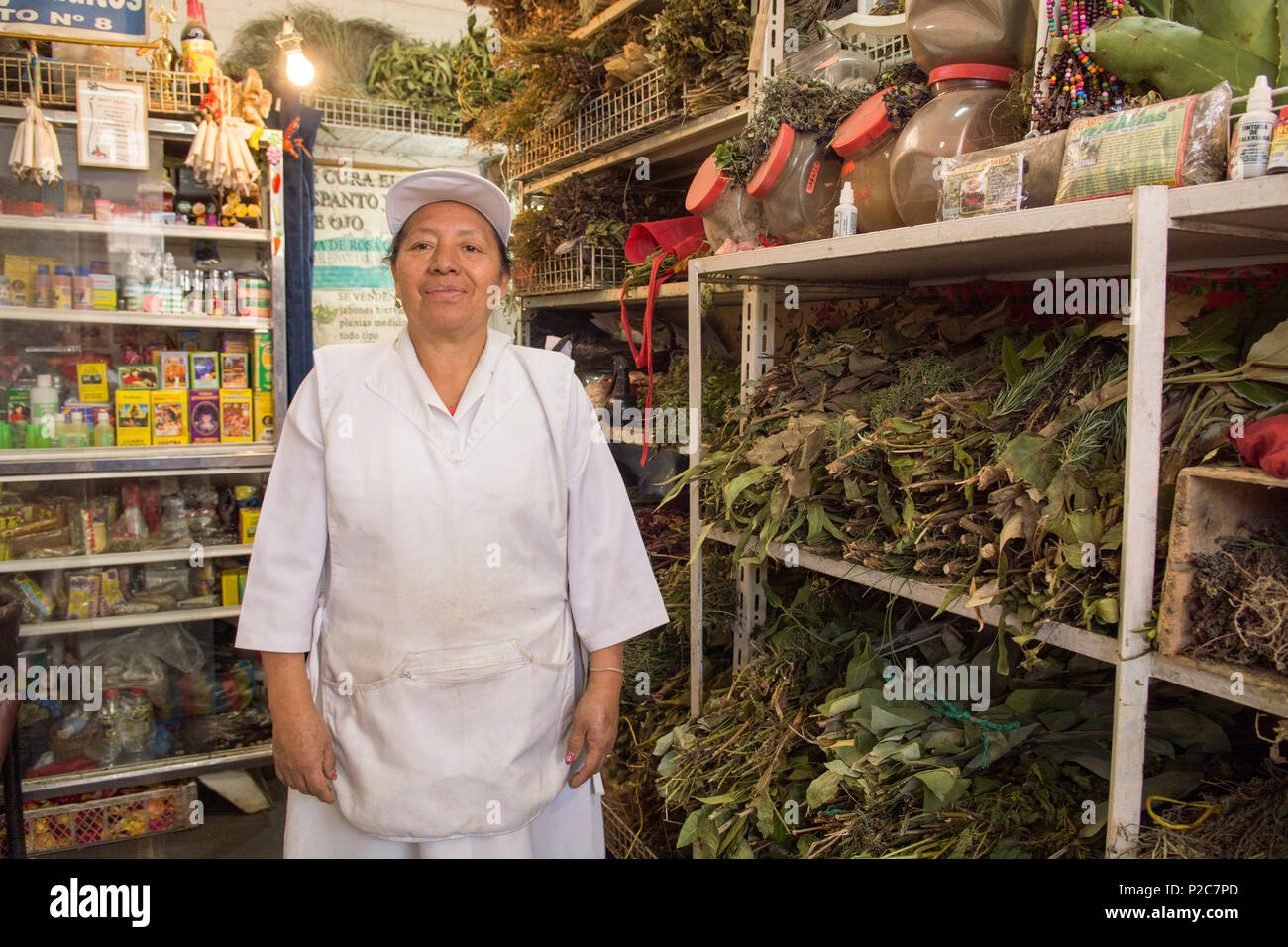 Herbal healer Rosa Mercedes in her shop in the San Francisco Market, which she shows to visitors during the walking tour through - Stock Image