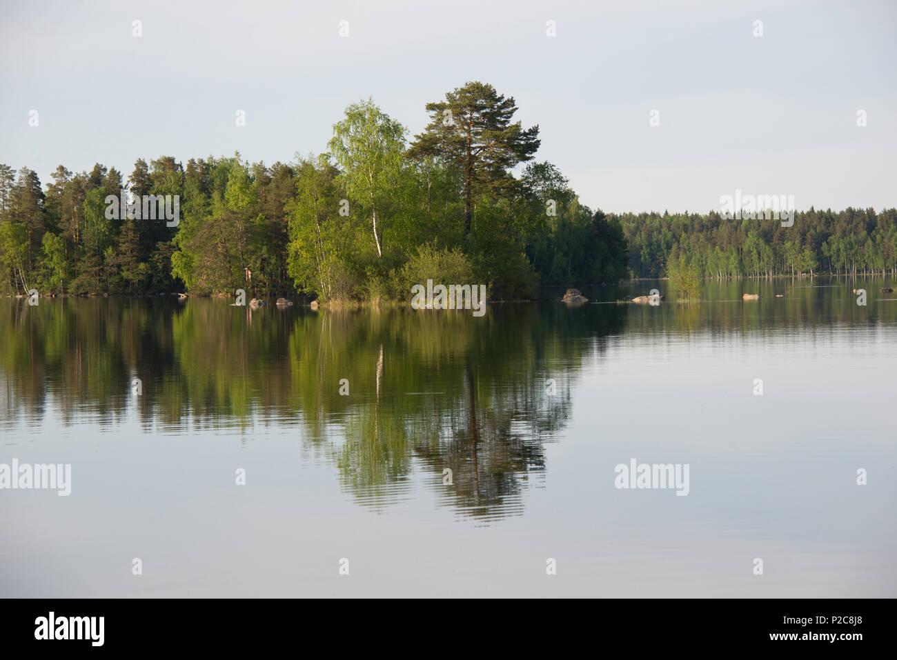 Lake Kukkia water reflections. Lake Kukkia, Luopioinen, Finland. 24.5.2018 - Stock Image