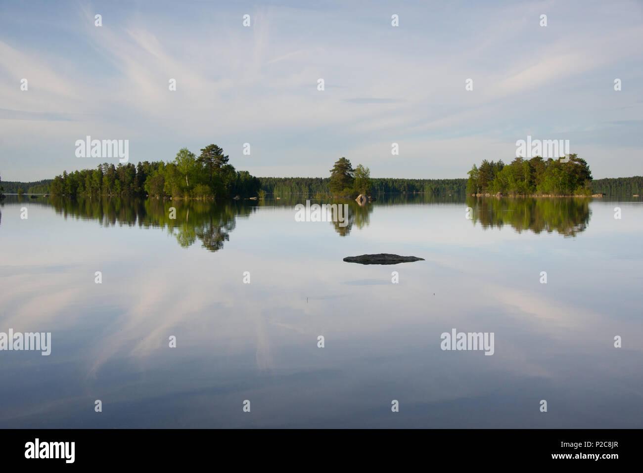 Lake Kukkia water reflections. Lake Kukkia, Luopioinen, Finland. - Stock Image