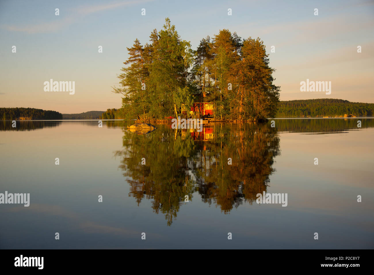 Sunset reflection. Lake Kukkia, Luopioinen, Finland. - Stock Image