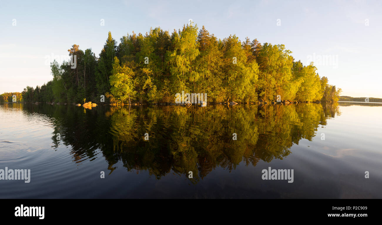 Sunset panorama from moving boat - Stock Image