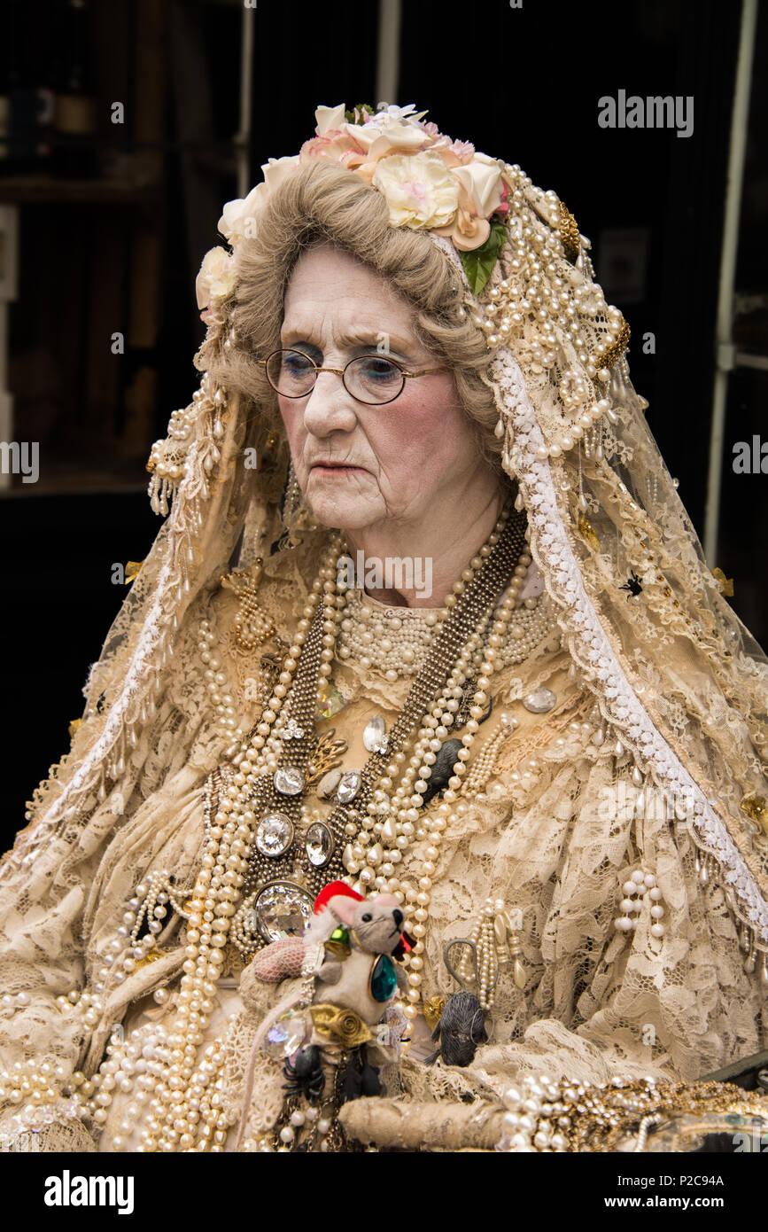 A 'Mrs Havisham' character in costume. - Stock Image