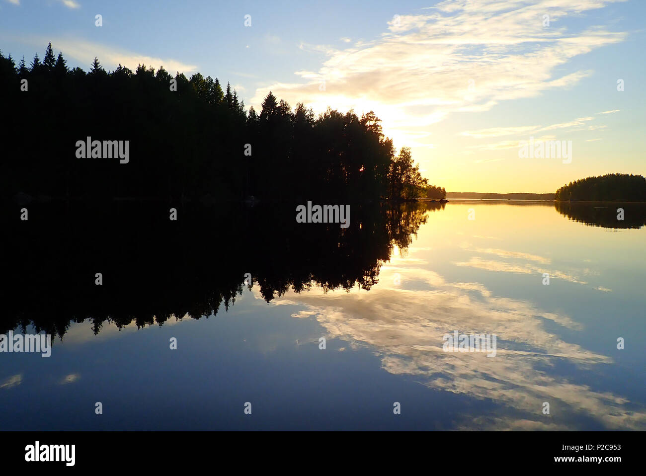 Sunset reflections. Lake Kukkia, Luopioinen, Finland. 24.6.2018 - Stock Image