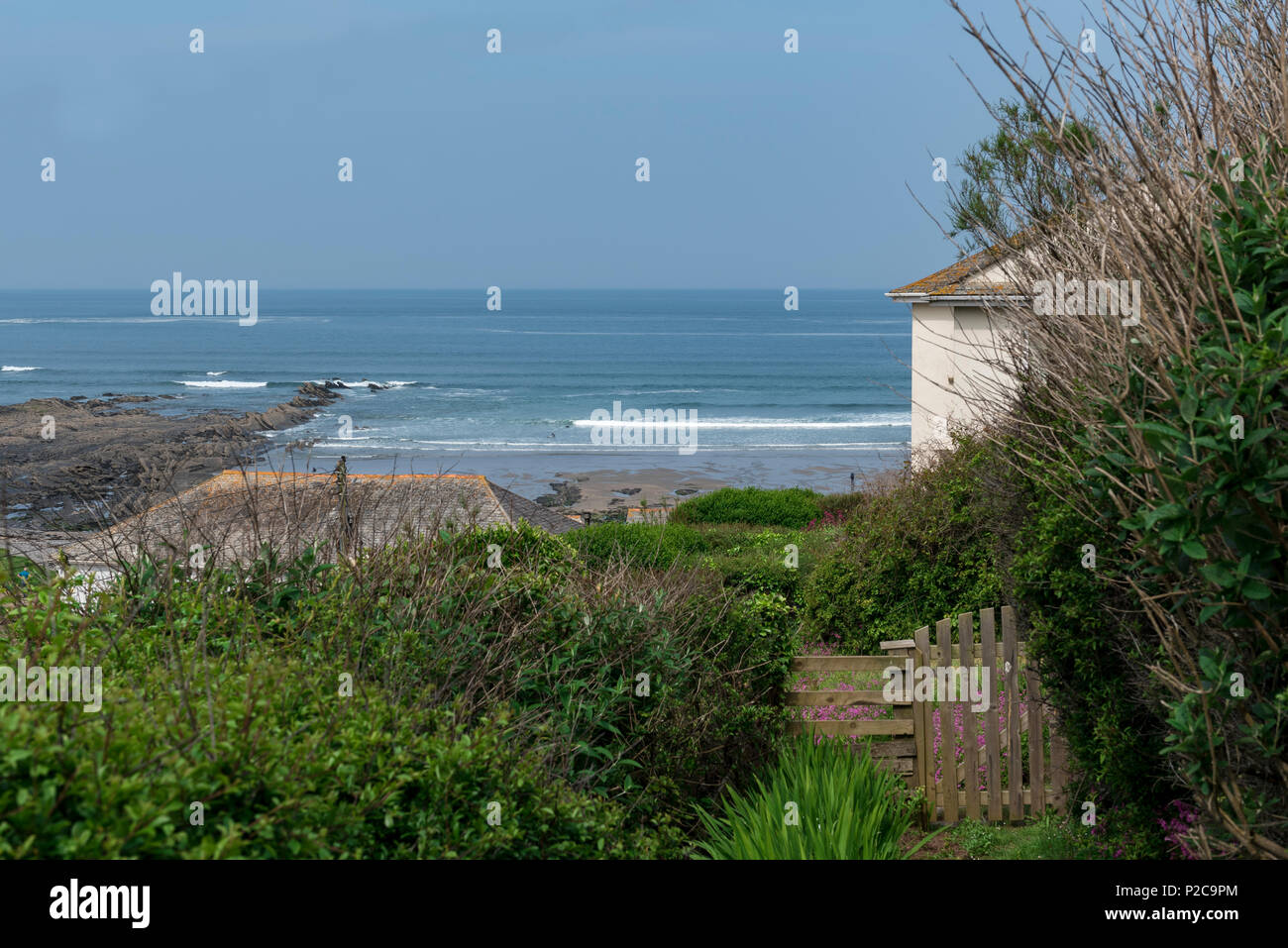 Cottage with a glorious seaview as seen from a section of the south west coast path at Crackington Haven Cornwall. - Stock Image