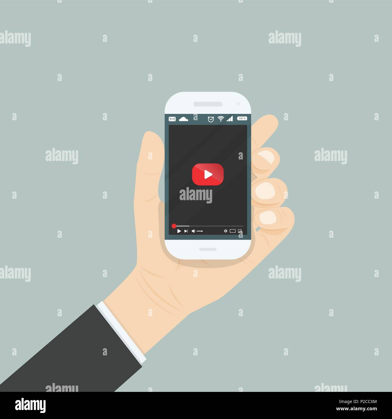 Hand holding smartphone with video player for website on the screen