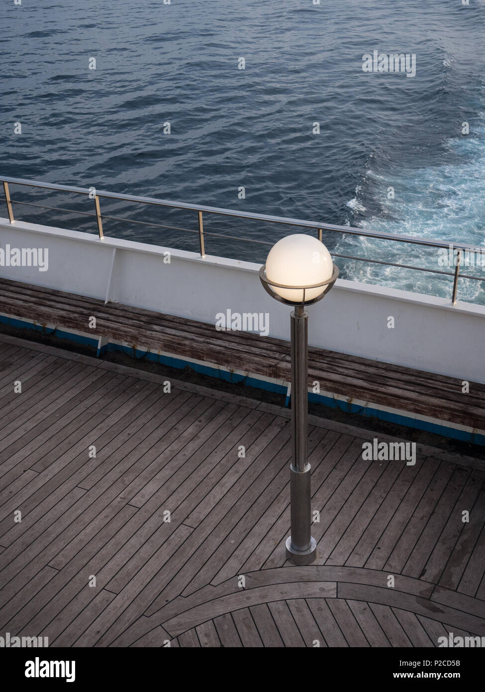 lamp post on a ferry deck at sunset Stock Photo