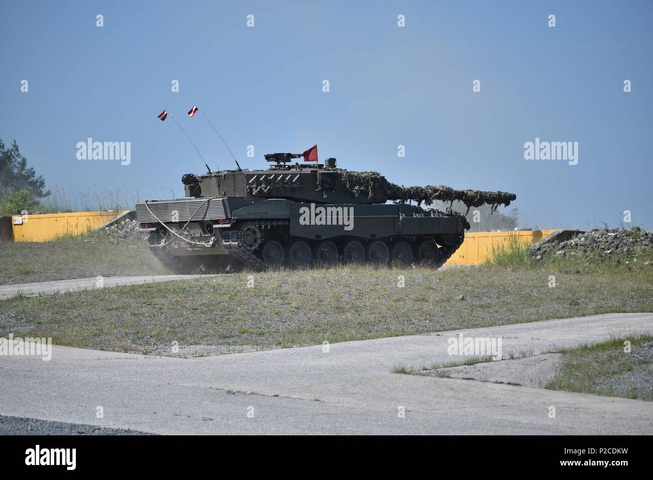 An Austrian Leopard 2A4 tank, operated by Austrian soldiers assigned to 6th Tank Company, 14th Panzer Battalion, fires at its target during the Strong Europe Tank Challenge (SETC), at the 7th Army Training Command's Grafenwoehr Training Area, Grafenwoehr, Germany, June 04, 2018, June 4, 2018. U.S. Army Europe and the German Army co-host the third Strong Europe Tank Challenge at Grafenwoehr Training Area, June 3 - 8, 2018. The Strong Europe Tank Challenge is an annual training event designed to give participating nations a dynamic, productive and fun environment in which to foster military part - Stock Image