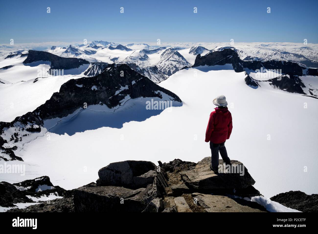 Norway, Oppland, Vaga, Jotunheimen National Park, trekker at the summit of Galdhopiggen, the tallest mountain in Norway and Scandinavia at 2469m - Stock Image