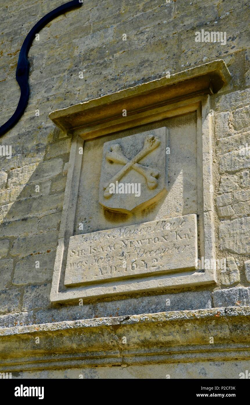 Plaque on wall outside Woolsthorpe Manor, Lincolnshire, England, commemorating the birth of Sir Isaac Newton on December 25th 1642 - Stock Image