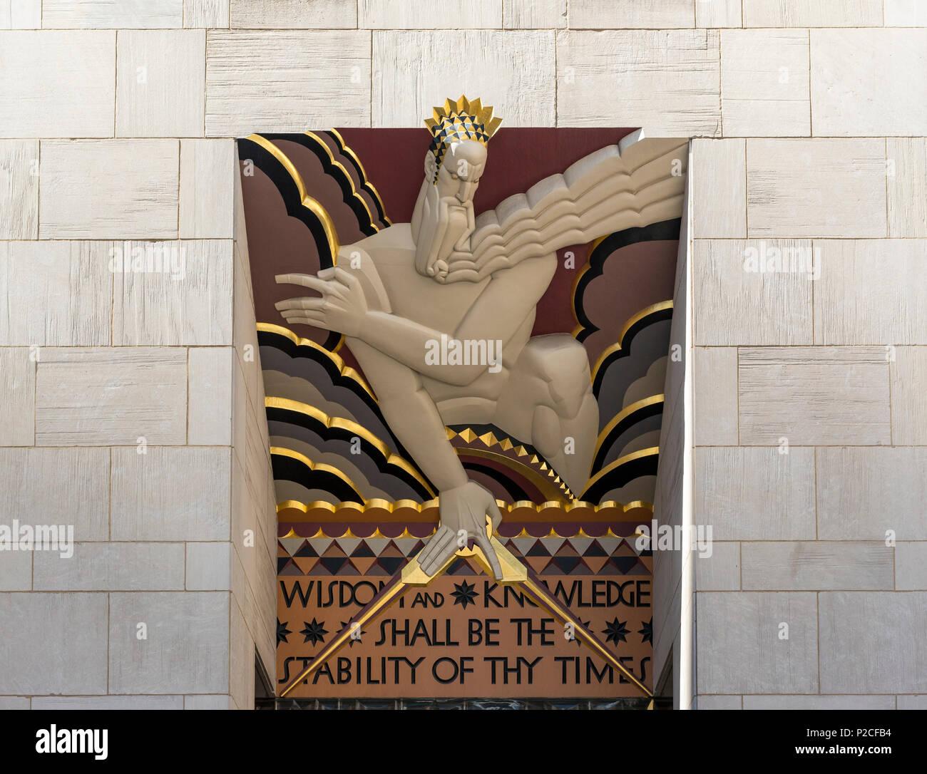 Art Deco sculpture Wisdom and Knowledge at entrance to 30 Rockefeller Plaza (Comcast Building), Rockefeller Center, New York, USA - Stock Image