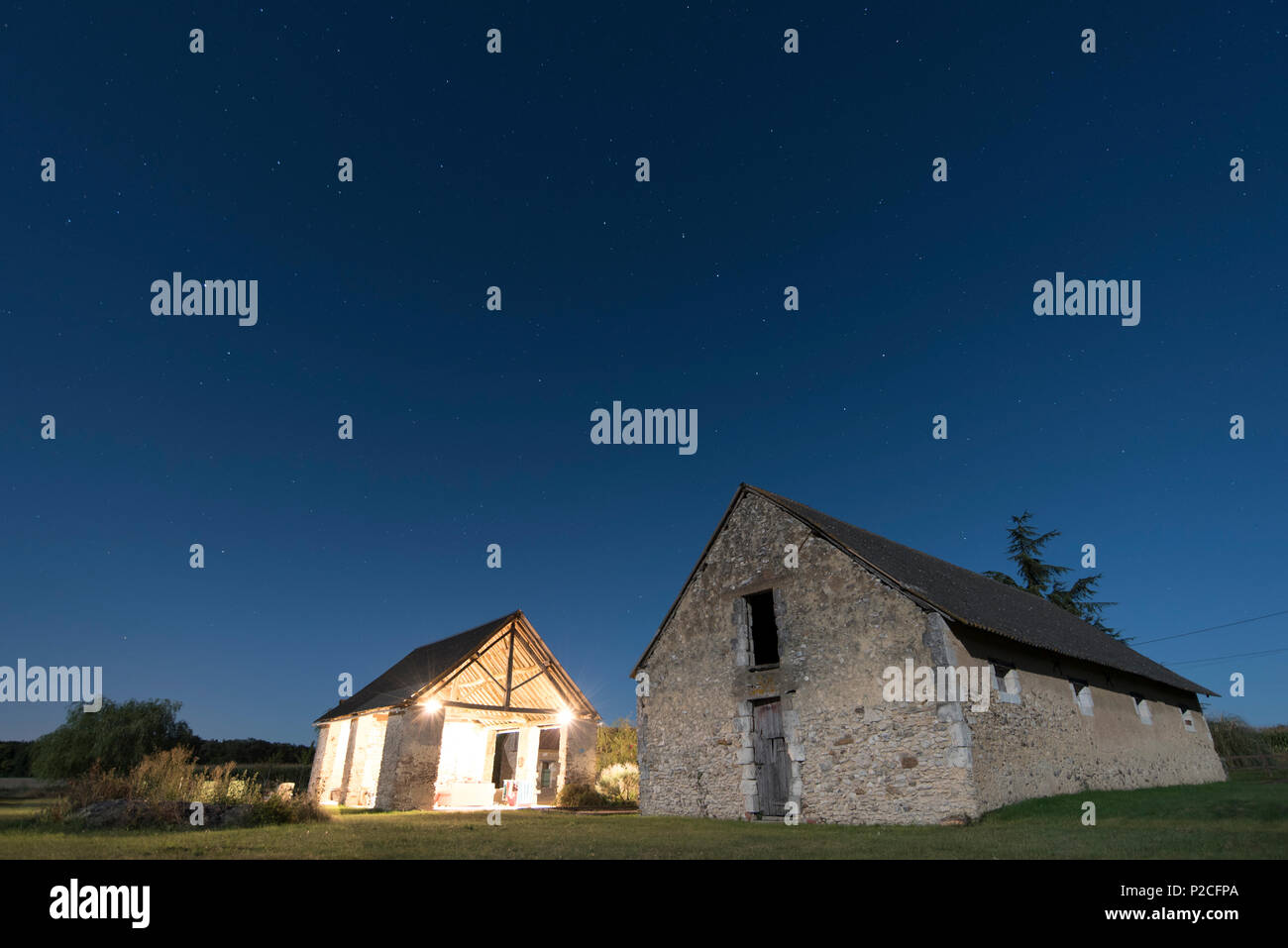 Moon lit barns on a French farm - Stock Image
