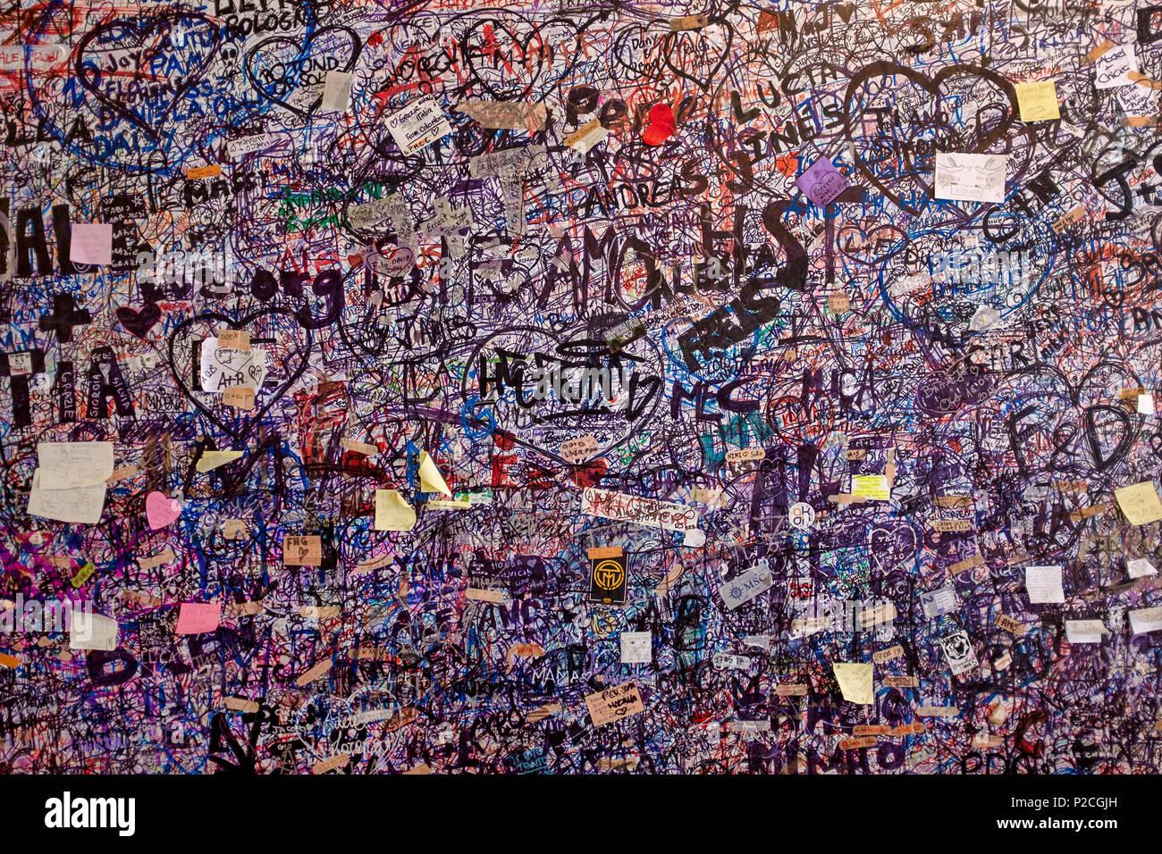 Vandalism over the walls of Juliet's House, Verona, Italy - Stock Image