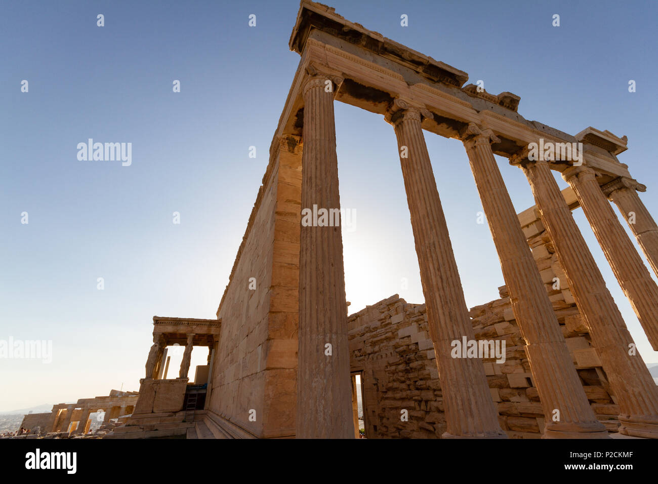 Columns of a temple on the Acropolis of Athens, Greece photographed from a low perspective - Stock Image