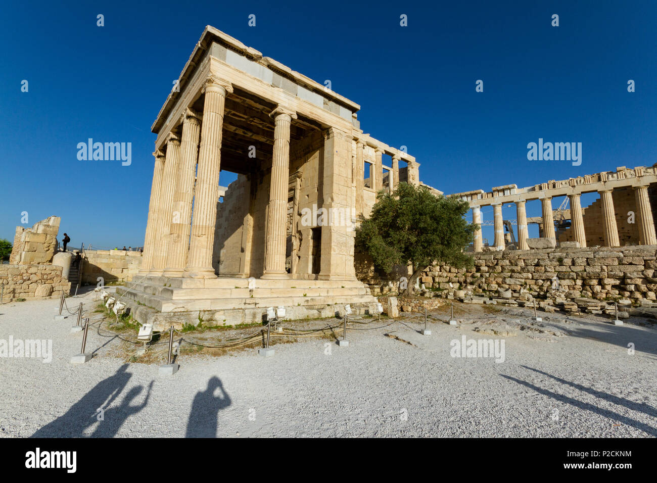 Temple ruins on the Acropolis in Athens in Greece and shadows of tourists taking photos - Stock Image