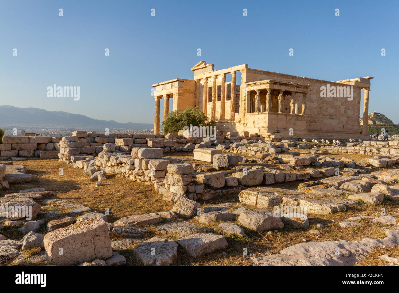 Erechtheum temple ruins on the Acropolis in Athens, Greece on an June afternoon - Stock Image