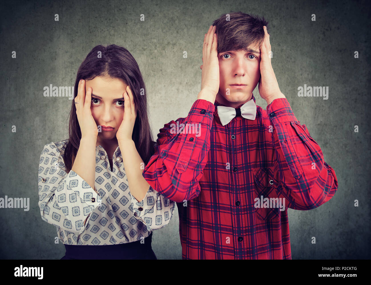Young man and woman in misunderstanding looking upset and having conflict - Stock Image