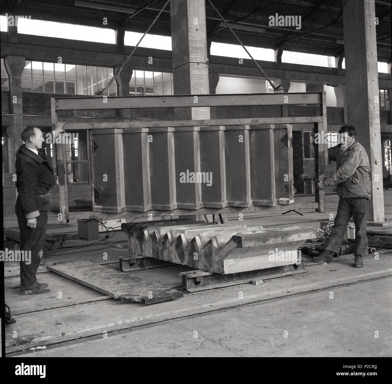 1960s, two male workers producing precast concrete wall
