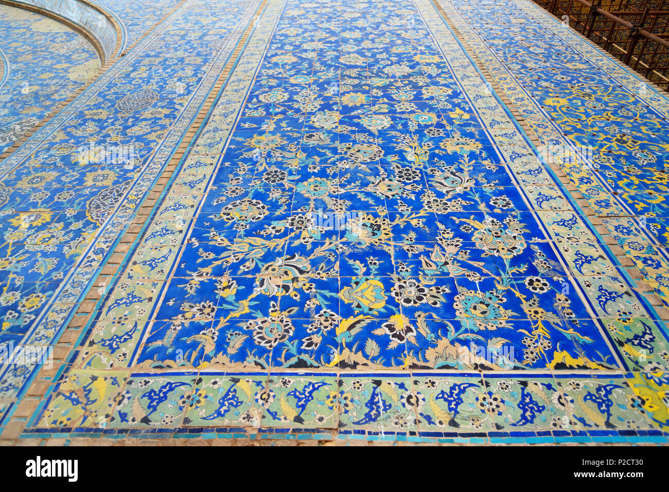 Decorated with colorful tiles in indoor yard of Shah Mosque or Imam Mosque in Isfahan. Iran - Stock Image