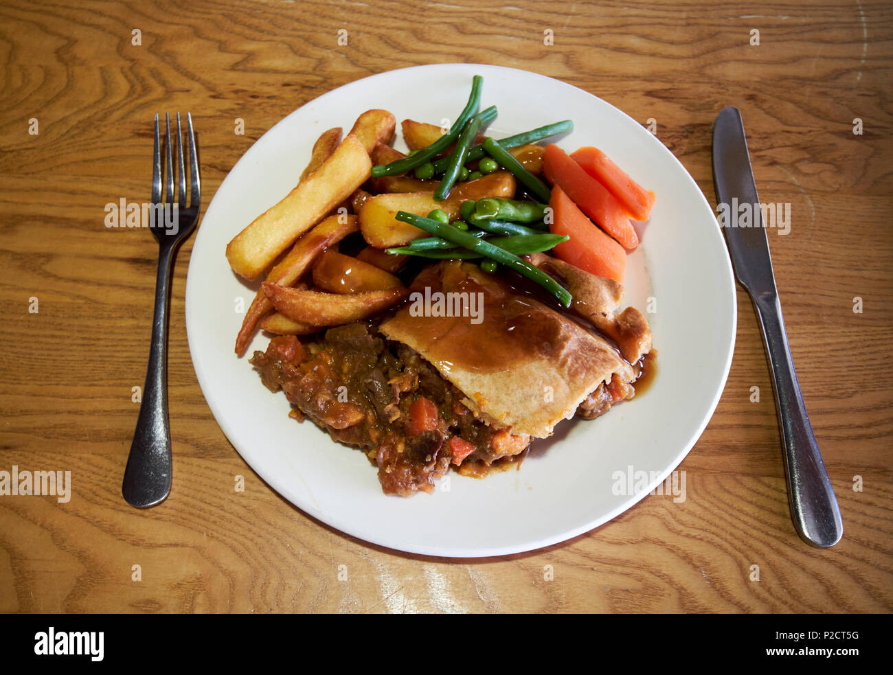 steak pie and chips and 2 veg locally produced meal in Cumbria England UK - Stock Image