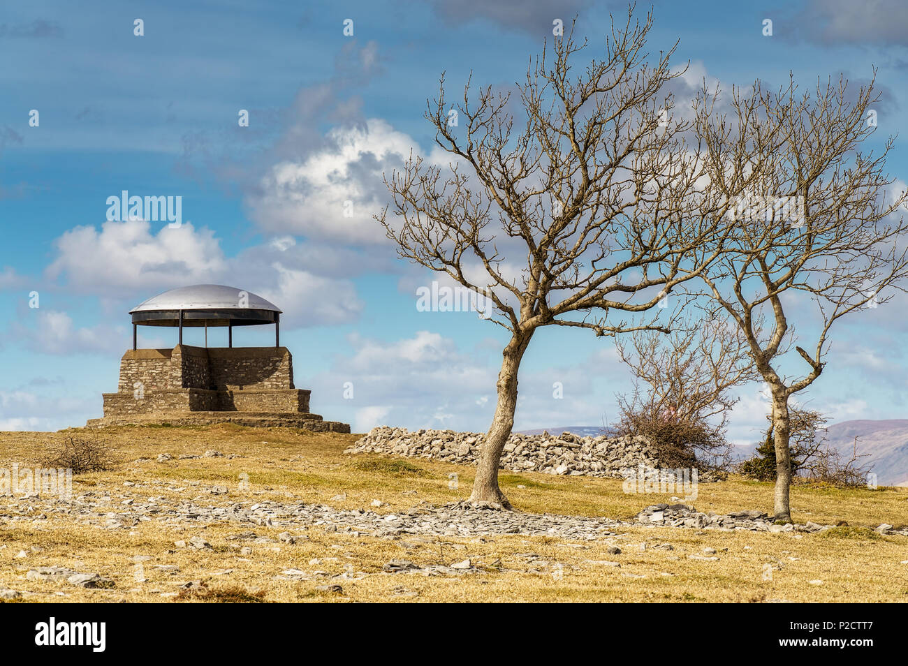 The mushroom on Scout scar, Kendal, with Ash trees. - Stock Image