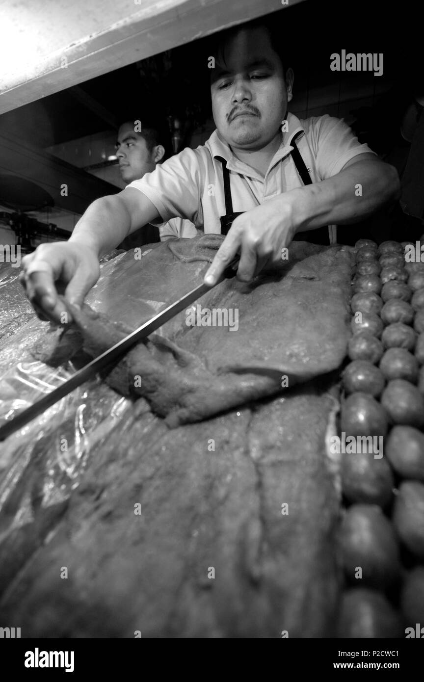 Mexico, Oaxaca State, Oaxaca, grilled meat seller on the market - Stock Image